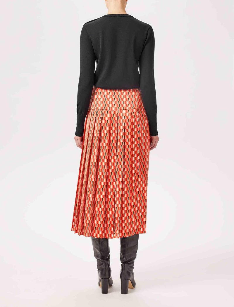 pleated geo print midi skirts