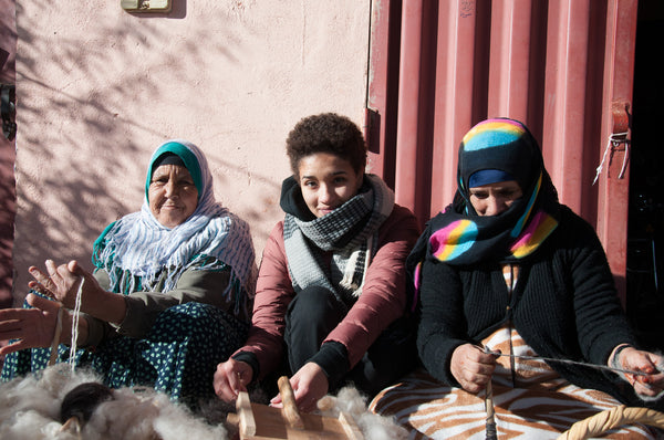 Our founder, Imane with two other Moroccan artisans. Both artisans are women.