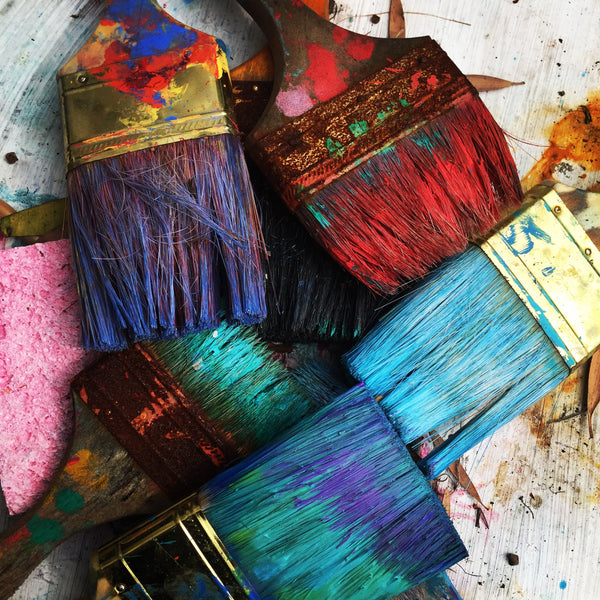 Colourful paint brushes for wall decor