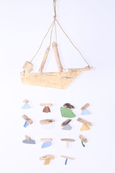Hanging boat with beach glass