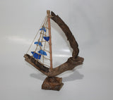 Driftwood Boat with Blue Sail
