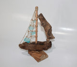 Driftwood Boat with Light Blue Sail
