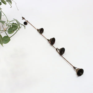5 Brass bells on a rope