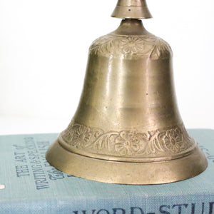 Vintage brass bell with floral design
