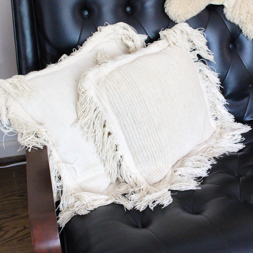 Vintage cream pillow with fringe