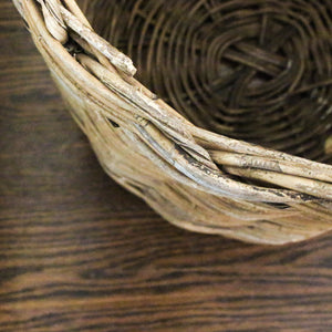 Large primitive woven plant basket