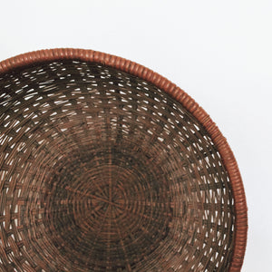 Dark wicker round basket
