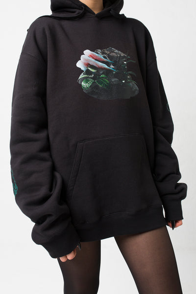 fashion brand BONDY photoshoot showcasing handmade HARLEY black cotton oversized hoodie with digital print on front and back shown on a size small model, part of the new collection DREY:MA. front view