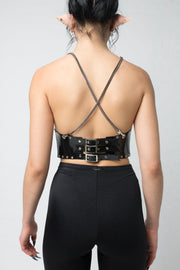 fashion brand BONDY photoshoot showcasing handmade COSIMA black PVC corset with chain detail shown on size small model, part of new collection DREY:MA. back view