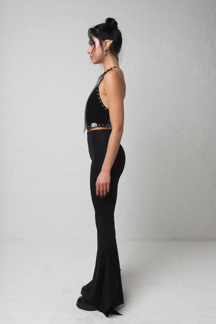 fashion brand BONDY showcasing handmade SERAPHINA  black high waisted side slit flare pants/trousers shown on a size small model, part of the new DREY:MA collection. full body side view