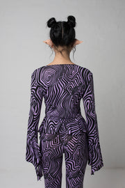 fashion brand BONDY photoshoot showcasing handmade AURORA abstract long-sleeve purple and black flare top on size small model, part of new collection DREY:MA. back view