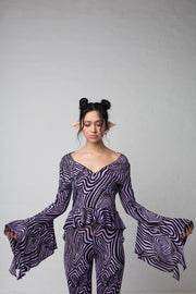 fashion brand BONDY photoshoot showcasing handmade AURORA abstract long-sleeve purple and black flare top on size small model, part of new collection DREY:MA. front view