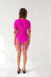 Fuchsia chandelier dress in glass coated and chrome connection rings with V neckline and glass drops around hem
