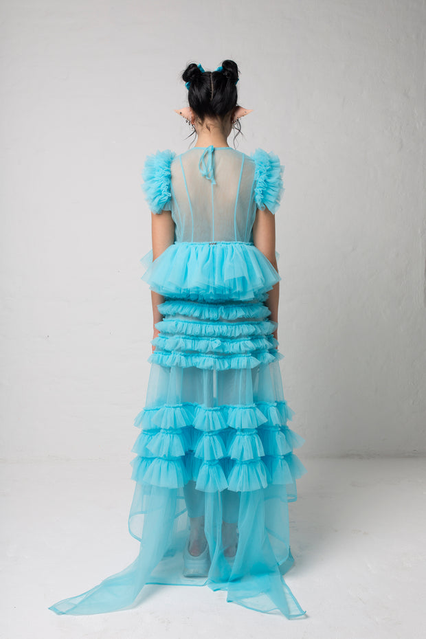 fashion brand BONDY photoshoot showcasing handmade FLEUR ice blue cropped, sheer ruffle 100% tulle top shown on a size small, part of the new collection DREY:MA. full body back view