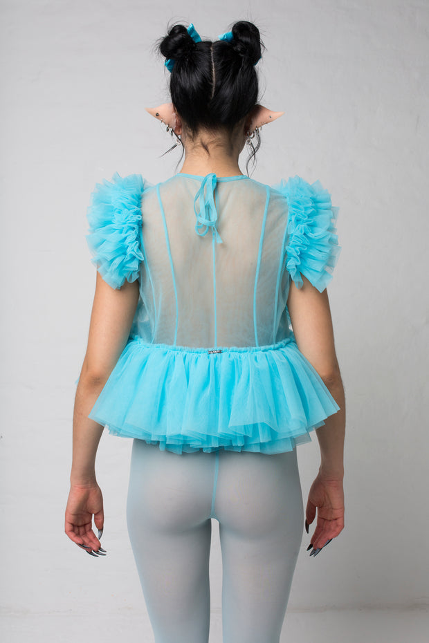 fashion brand BONDY photoshoot showcasing handmade FLEUR ice blue cropped, sheer ruffle 100% tulle top shown on a size small, part of the new collection DREY:MA. back view