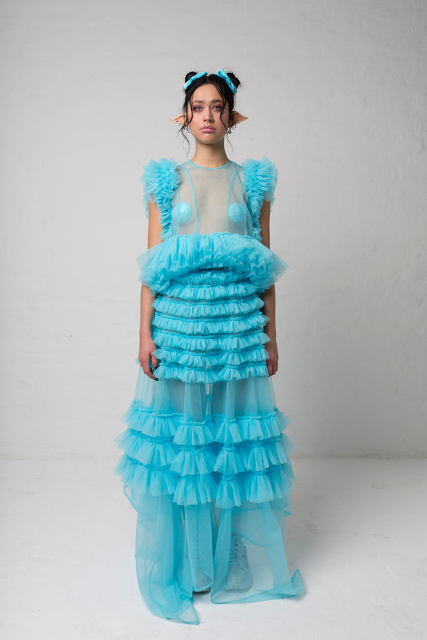 fashion brand BONDY photoshoot showcasing handmade FLEUR ice blue cropped, sheer ruffle 100% tulle top shown on a size small, part of the new collection DREY:MA. full body front view