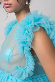 fashion brand BONDY photoshoot showcasing handmade FLEUR ice blue cropped, sheer ruffle 100% tulle top shown on a size small, part of the new collection DREY:MA. detail side view