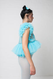 fashion brand BONDY photoshoot showcasing handmade FLEUR ice blue cropped, sheer ruffle 100% tulle top shown on a size small, part of the new collection DREY:MA. side view