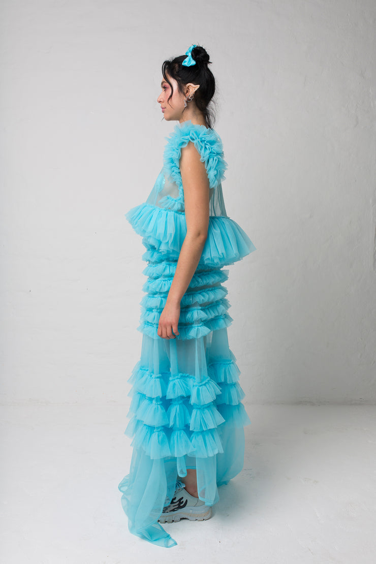 fashion brand BONDY photoshoot showcasing handmade FLEUR ice blue cropped, sheer ruffle 100% tulle top shown on a size small, part of the new collection DREY:MA. full body side view