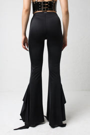 fashion brand BONDY showcasing handmade SERAPHINA  black high waisted side slit flare pants/trousers shown on a size small model, part of the new DREY:MA collection. back view