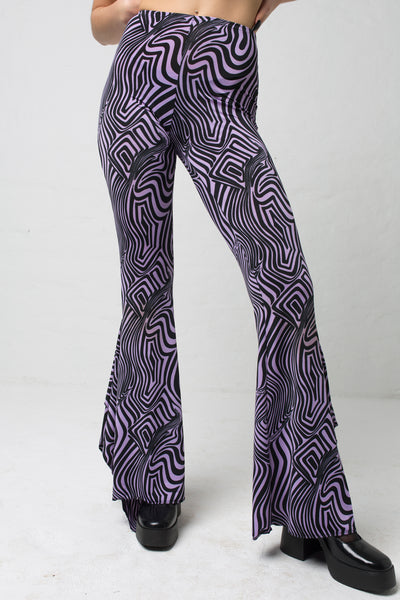 fashion brand BONDY showcasing handmade SERAPHINA purple and black abstract high waisted side slit flare pants/trousers shown on a size small model, part of the new DREY:MA collection. front view