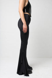 fashion brand BONDY showcasing handmade SERAPHINA  black high waisted side slit flare pants/trousers shown on a size small model, part of the new DREY:MA collection. side view