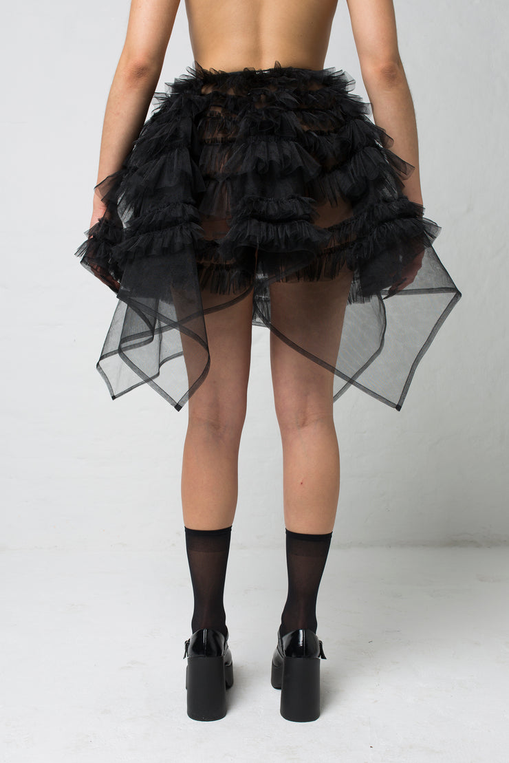 fashion brand BONDY showcasing handmade NERA high waisted double layered black tulle mini skirt with ruffle detail shown on size small model, part of the new collection DREY:MA. back view
