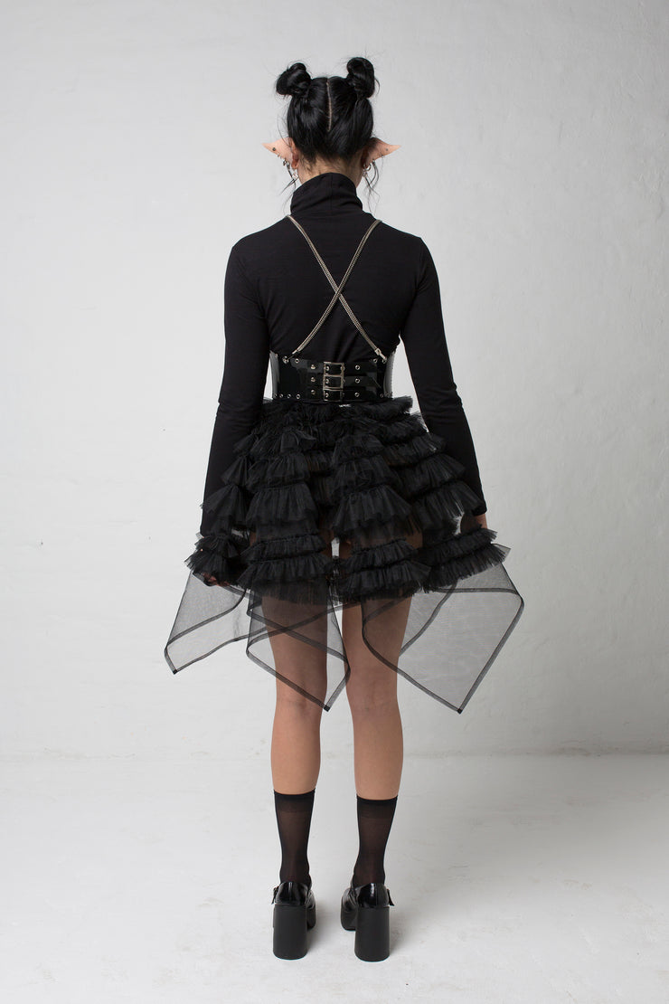 fashion brand BONDY showcasing handmade NERA high waisted double layered black tulle mini skirt with ruffle detail shown on size small model, part of the new collection DREY:MA. full body back view