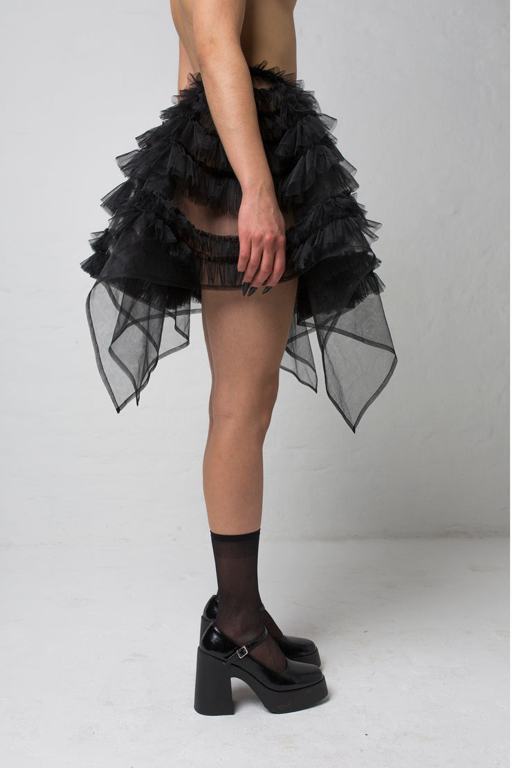 fashion brand BONDY showcasing handmade NERA high waisted double layered black tulle mini skirt with ruffle detail shown on size small model, part of the new collection DREY:MA. side view