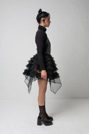 fashion brand BONDY showcasing handmade NERA high waisted double layered black tulle mini skirt with ruffle detail shown on size small model, part of the new collection DREY:MA. full body side view
