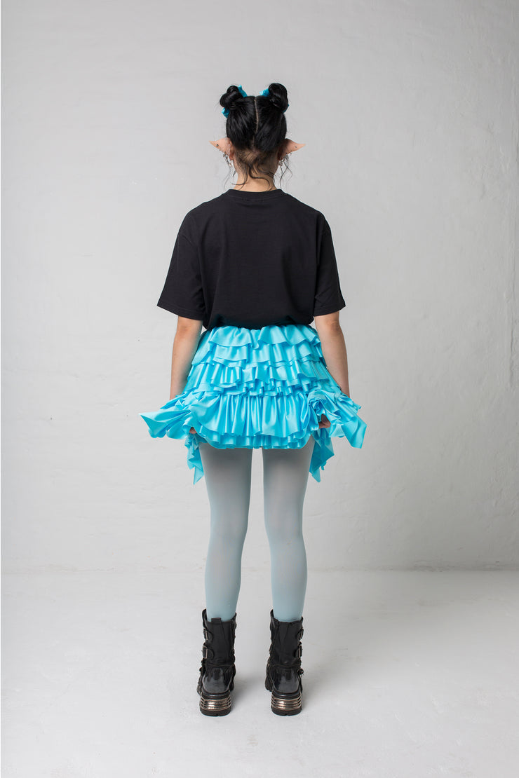 fashion brand BONDY photoshoot showcasing handmade CASSIA mini ruffle ice blue skirt shown on size small model, part of new collection DREY:MA. full body back view