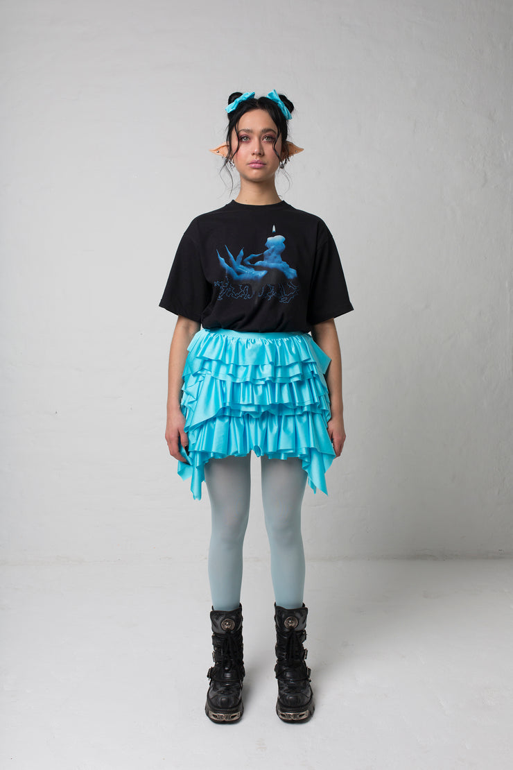 fashion brand BONDY photoshoot showcasing handmade CASSIA mini ruffle ice blue skirt shown on size small model, part of new collection DREY:MA. full body front view