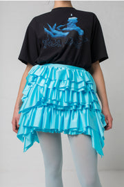 fashion brand BONDY photoshoot showcasing handmade CASSIA mini ruffle ice blue skirt shown on size small model, part of new collection DREY:MA. front view