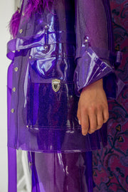 Purple glitter oversized PVC jacket with ostrich feather trim with flap pockets and press buttons in the front