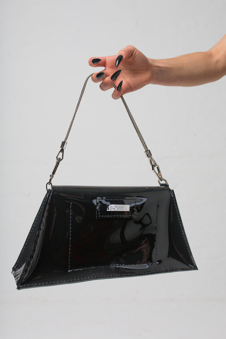 fashion brand BONDY showcasing handmade XENIA black 100% PVC bag with chain shoulder strap, part of the new collection DREY:MA. back view