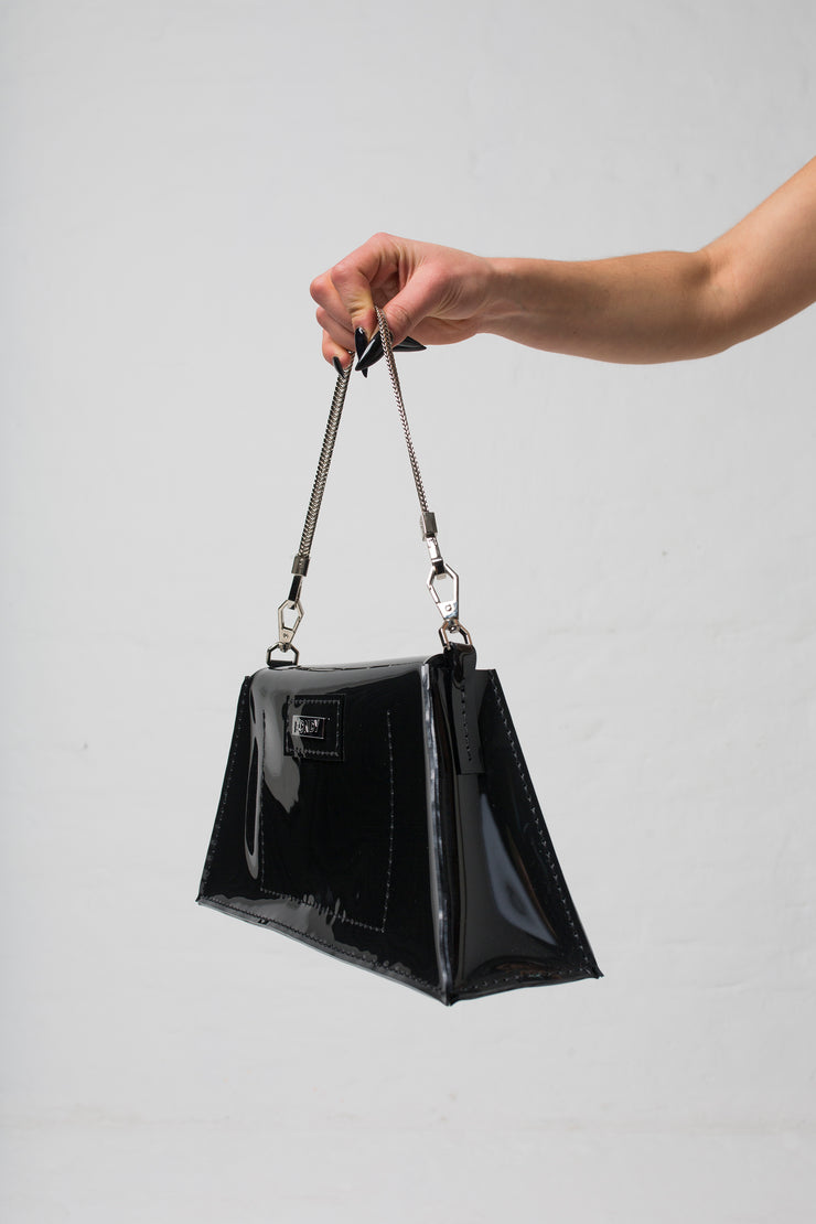 fashion brand BONDY showcasing handmade XENIA black 100% PVC bag with chain shoulder strap, part of the new collection DREY:MA. side view