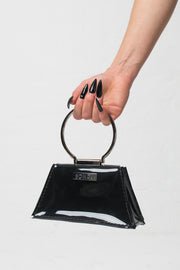 fashion brand BONDY showcasing handmade ZELDA black 100% PVC bag with big ring as handle, part of the new collection DREY:MA. back view