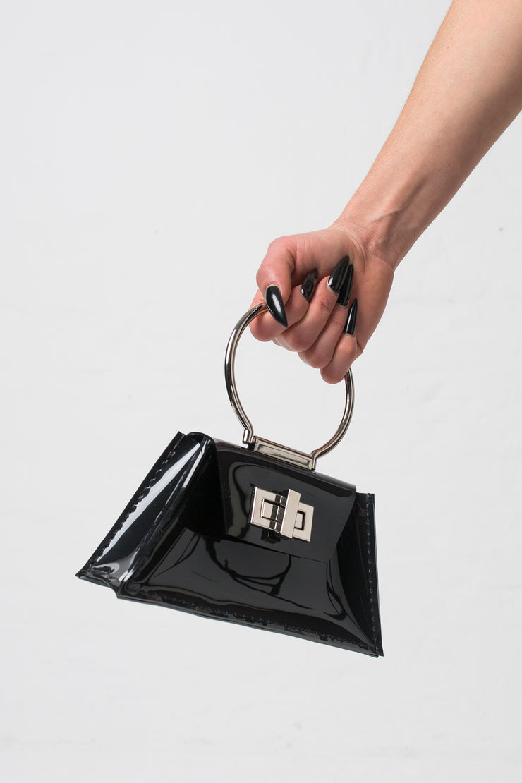 fashion brand BONDY showcasing handmade ZELDA black 100% PVC bag with big ring as handle, part of the new collection DREY:MA. side view