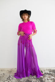 Violet wide leg pants with elastic material, scalloped hemline with extra ruffles