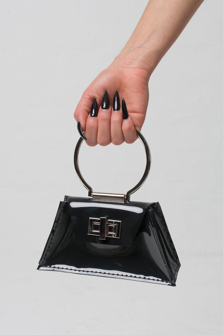 fashion brand BONDY showcasing handmade ZELDA black 100% PVC bag with big ring as handle, part of the new collection DREY:MA. front view