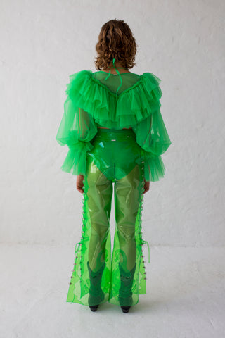 Green glitter PVC pants flared cut, laceable on the side with crocodile embroidery at the hem