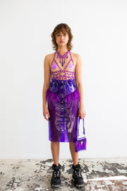 Purple glitter pencil skirt in PVC with ostrich feathers at hem with decorative belt loop