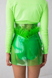 High cut green glitter PVC mini skirt with feather details and flame embroidery