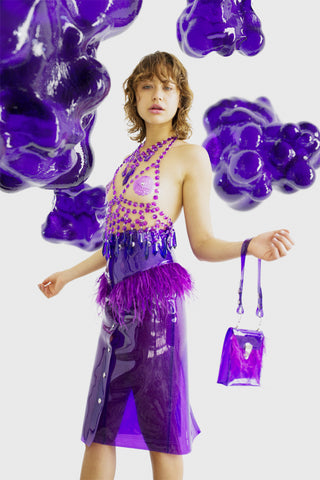 Purple glitter PVC mini bag with ostrich feather trim and contrasting hardware