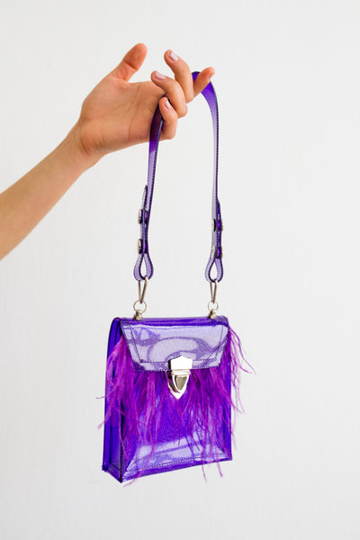Purple glitter PVC mini bag with ostrich feather trim and contrasting hardwarrePurple glitter PVC mini bag with ostrich feather trim and contrasting hardware