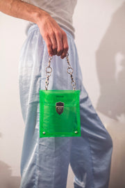 Green glitter PVC bag with heavy hardware and frame embroidery