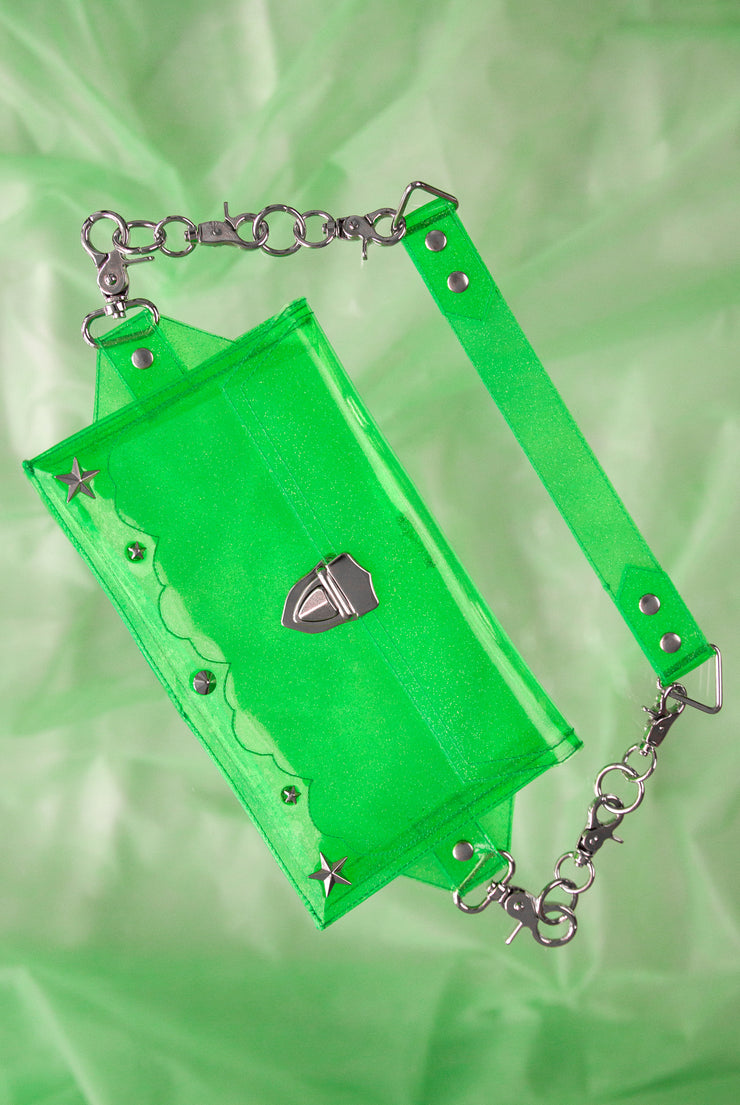 green glitter PVC bum bag with star rivets on the front and flame embroidery