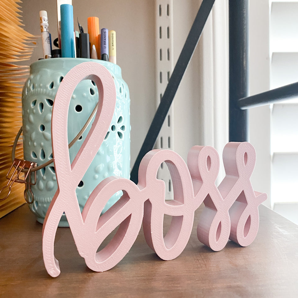 hand-lettered boss sign - decor piece shown in candy pink