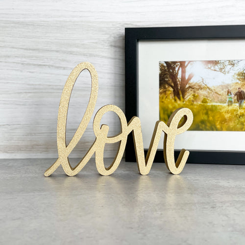 hand-lettered love sign