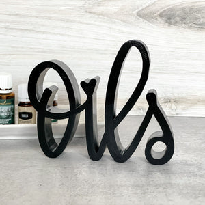 hand-lettered Oils sign